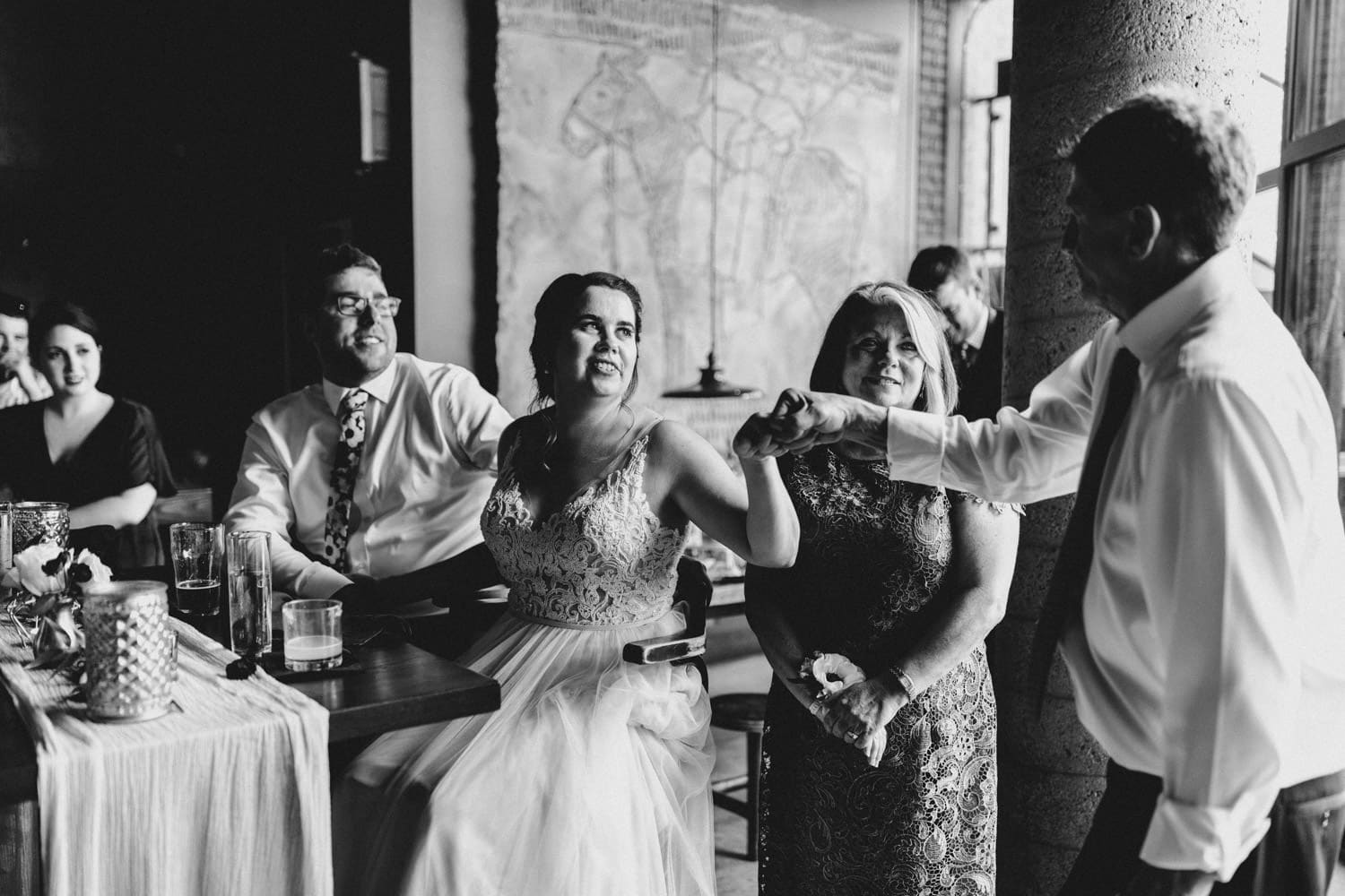 bride fist pumps father in law at downtown ottawa wedding