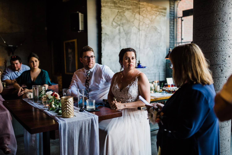 bride and groom listen to speeches - el camino wedding