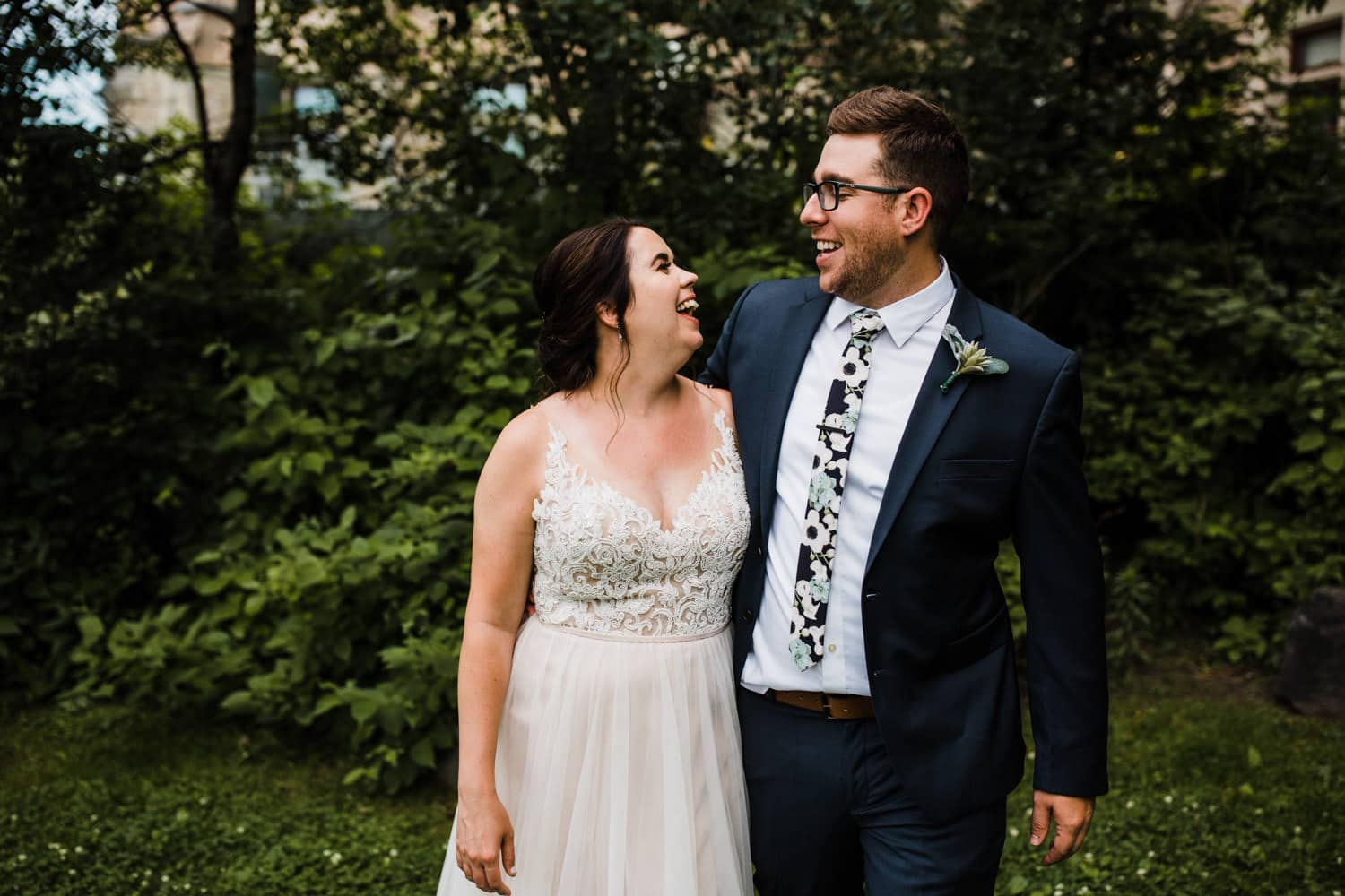 bride and groom laugh together - downtown ottawa wedding