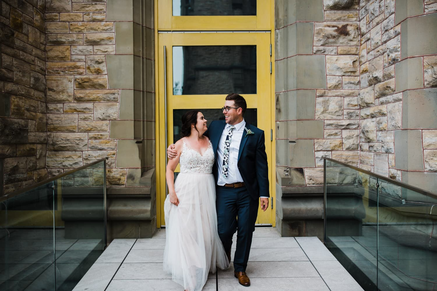 bride and groom walk together - carley teresa photography