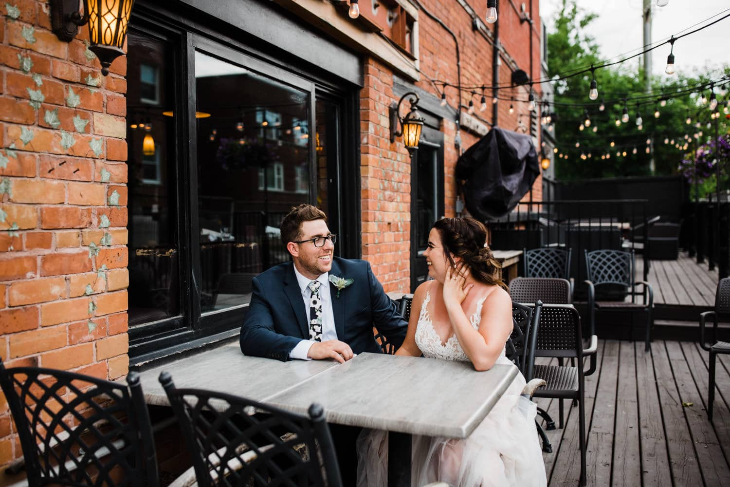 bride and groom sit on patio together - downtown ottawa wedding
