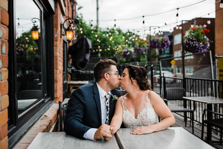 bride and groom kiss on patio - downtown ottawa wedding