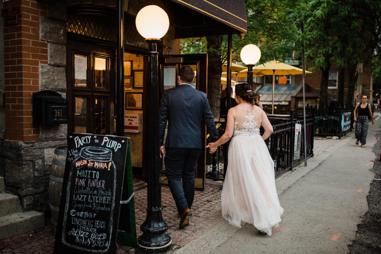 bride and groom walk into pub together - downtown ottawa wedding