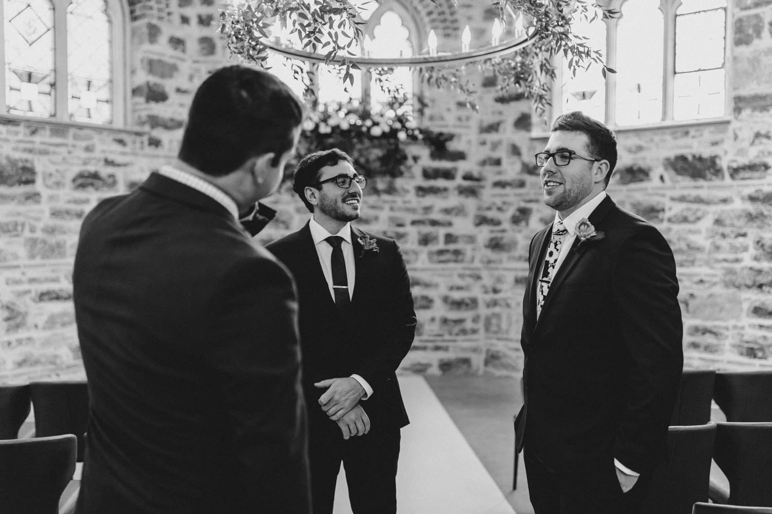 groom chats with groomsmen ahead of wedding ceremony