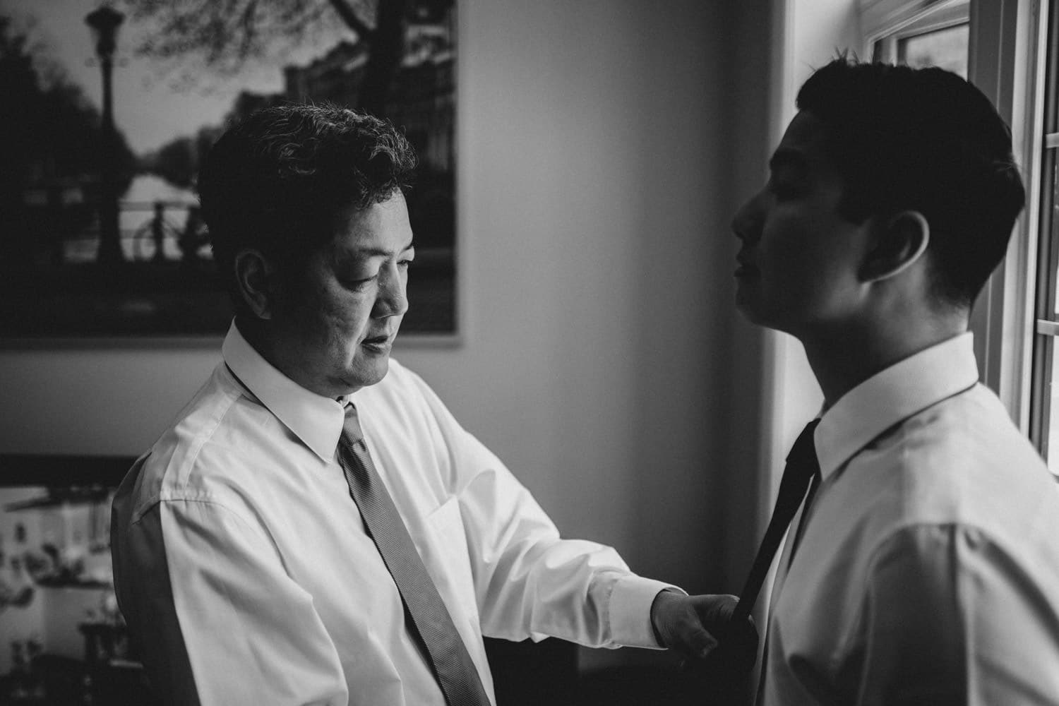groom's dad helping him with his tie