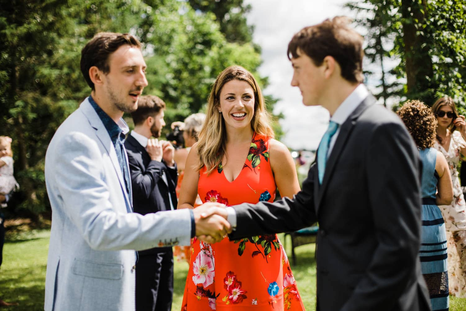 guests greet one other - backyard wedding ottawa