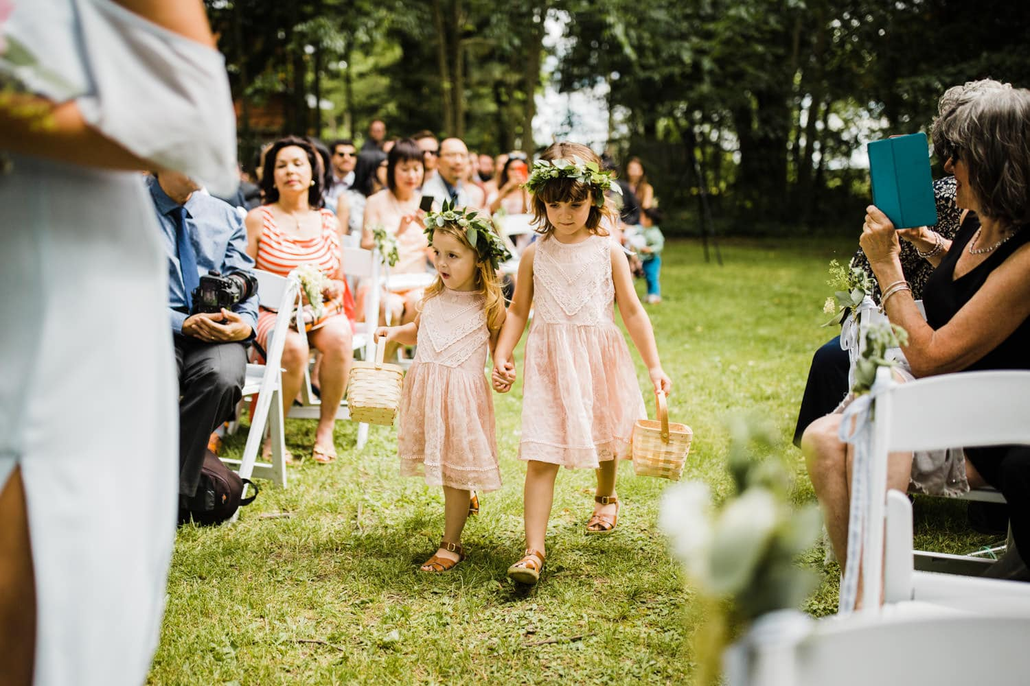 flower girls walk hand-in-hand - ottawa backyard wedding