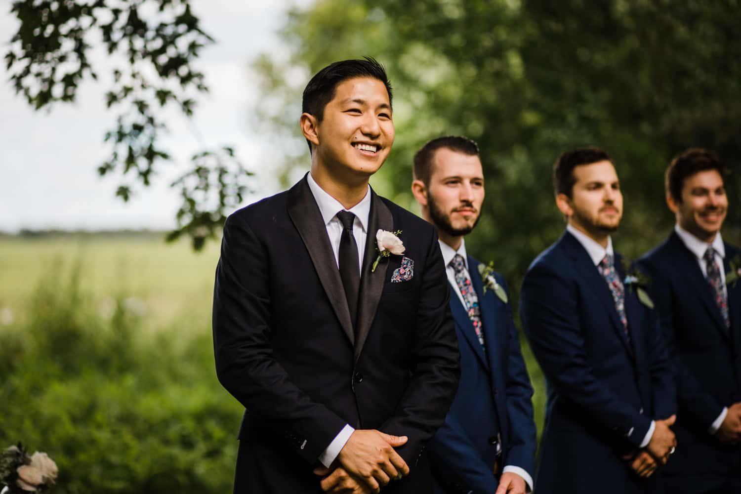 groom sees his bride walking down the aisle - carley teresa photography - backyard wedding