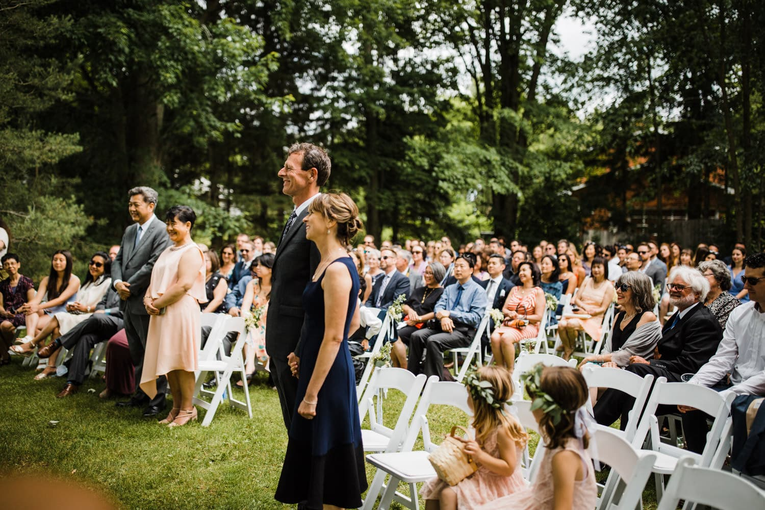 guests enjoy a backyard wedding ceremony