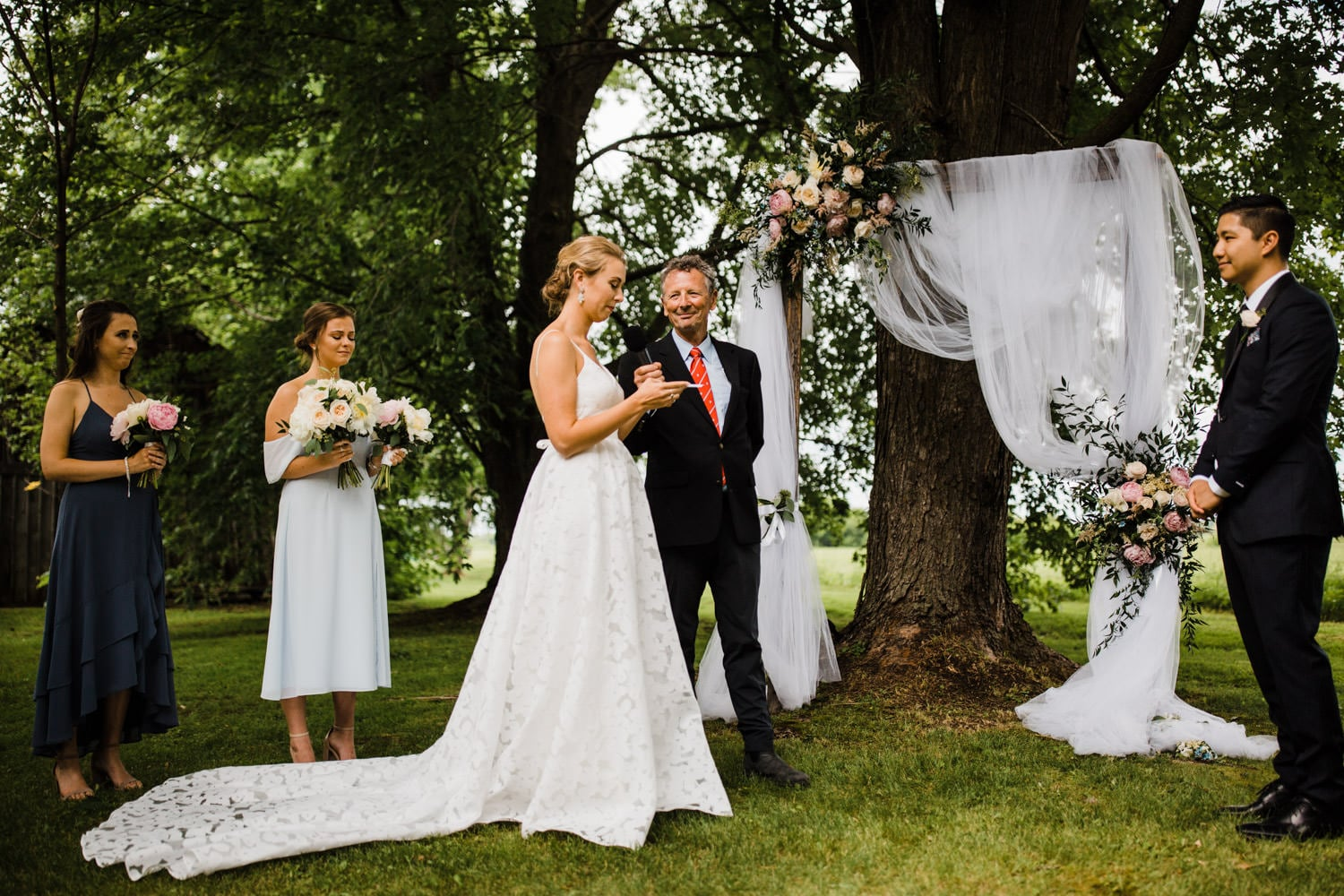 bride reads hand written vows - ottawa backyard wedding