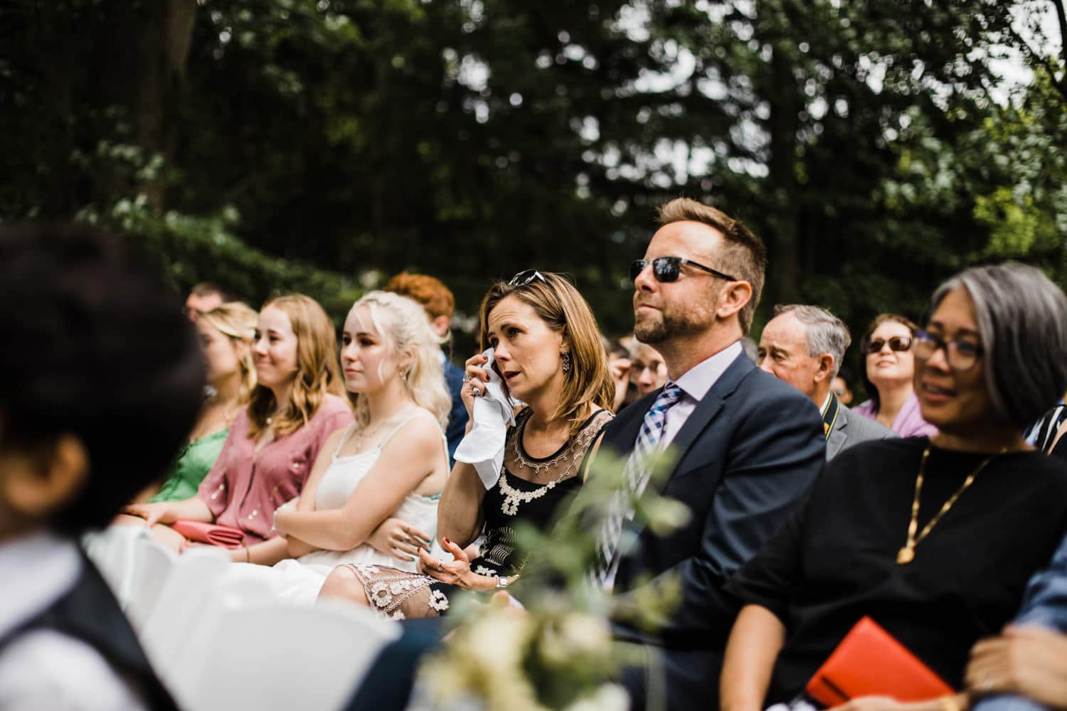 guests react during vows - ottawa backyard wedding