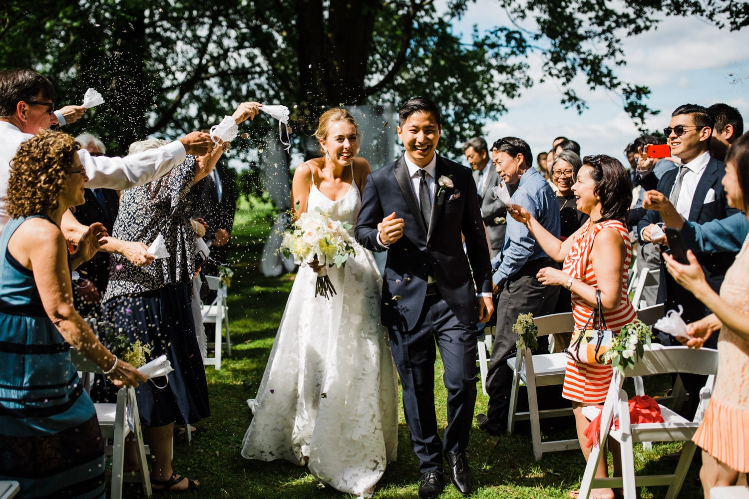 guests throw dried flowers at bride and groom - ottawa backyard wedding - carley teresa photography