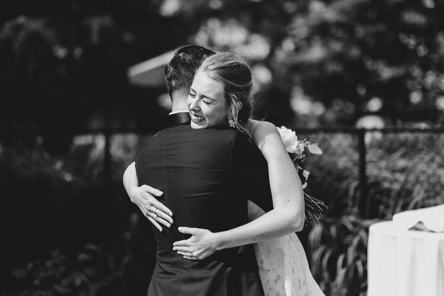 bride and groom hug and cry together after ceremony - carley teresa photography