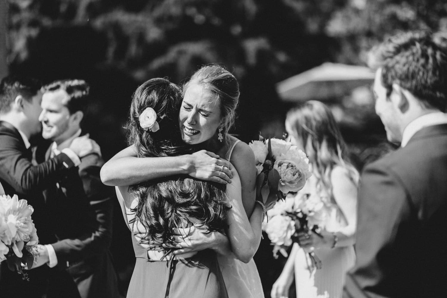 bride cries and hugs bridesmaid - carley teresa photography