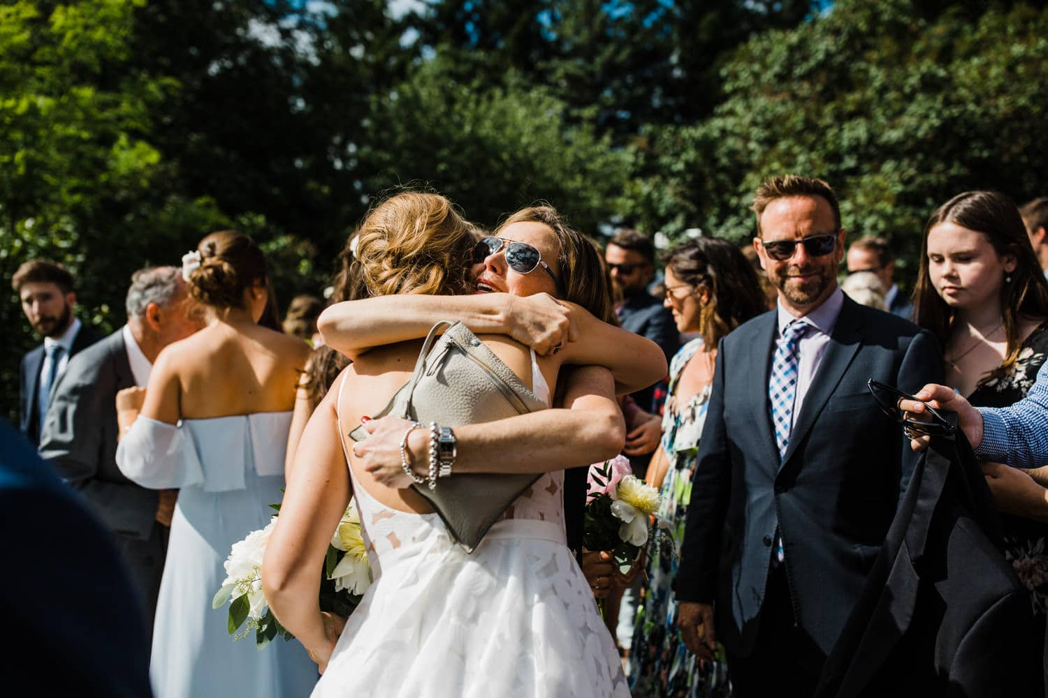 bride hugs guests after ceremony - ottawa backyard wedding