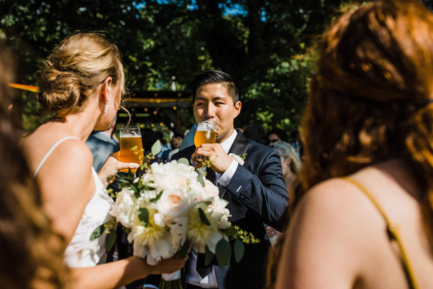 bride and groom drink a beer - ottawa backyard wedding