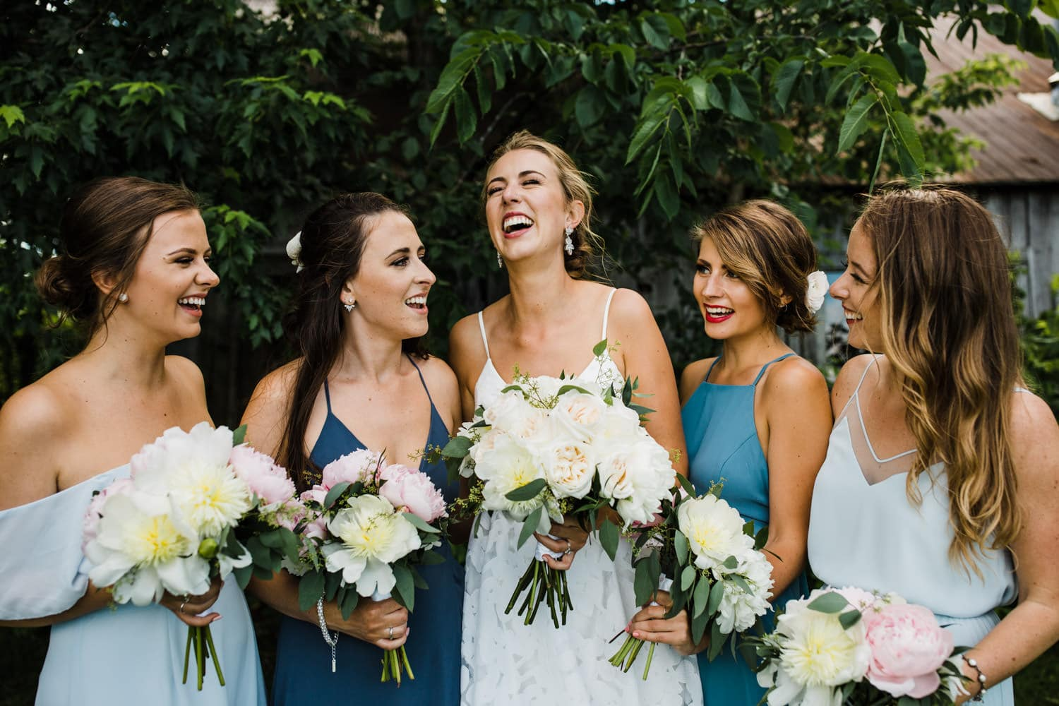 bride laugh with bridesmaids - carley teresa photography