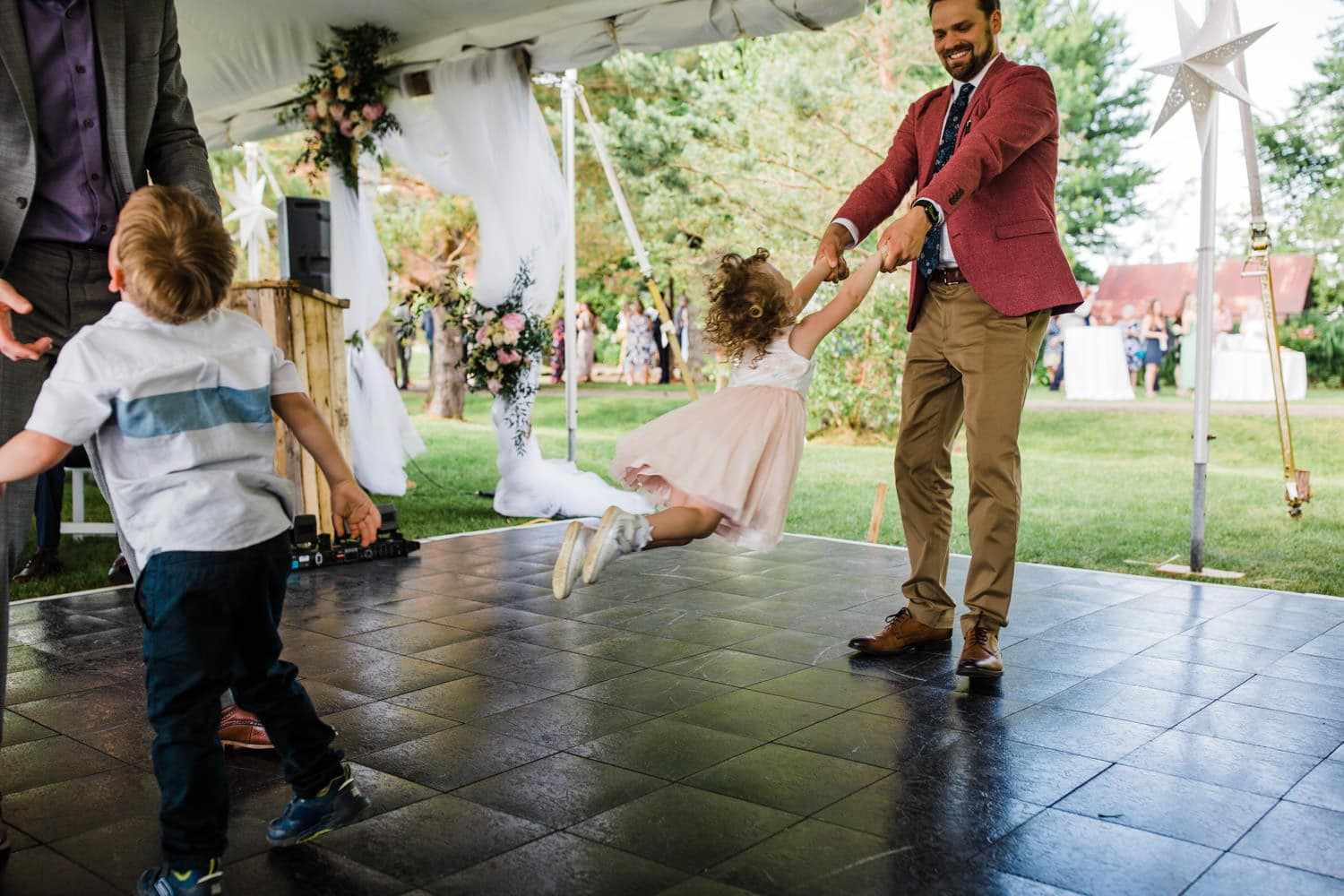 kids dance in tent - ottawa backyard wedding