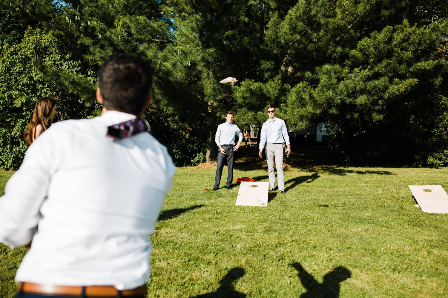 guests play yard games - ottawa backyard wedding