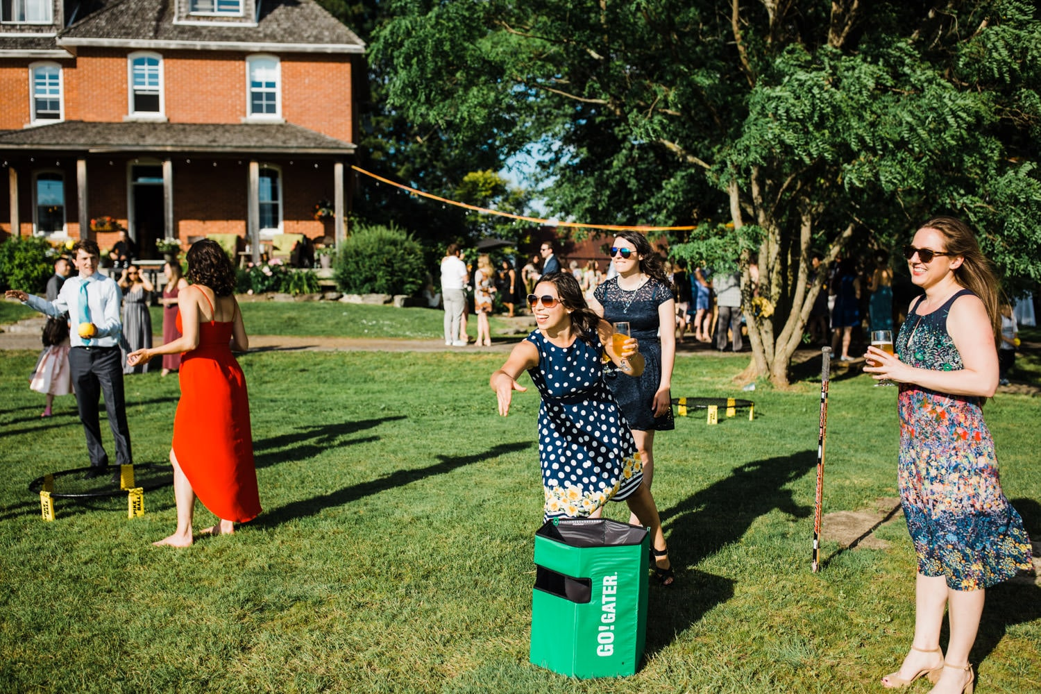 guests play lawn games - ottawa backyard wedding