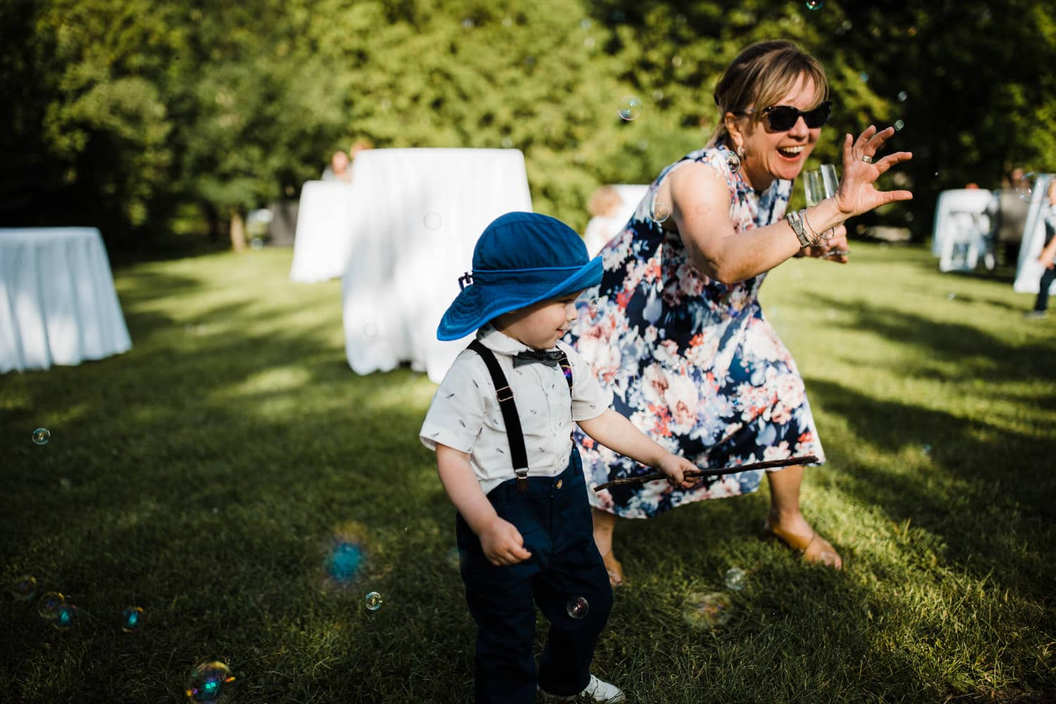 little boy plays with bubbles - ottawa backyard wedding