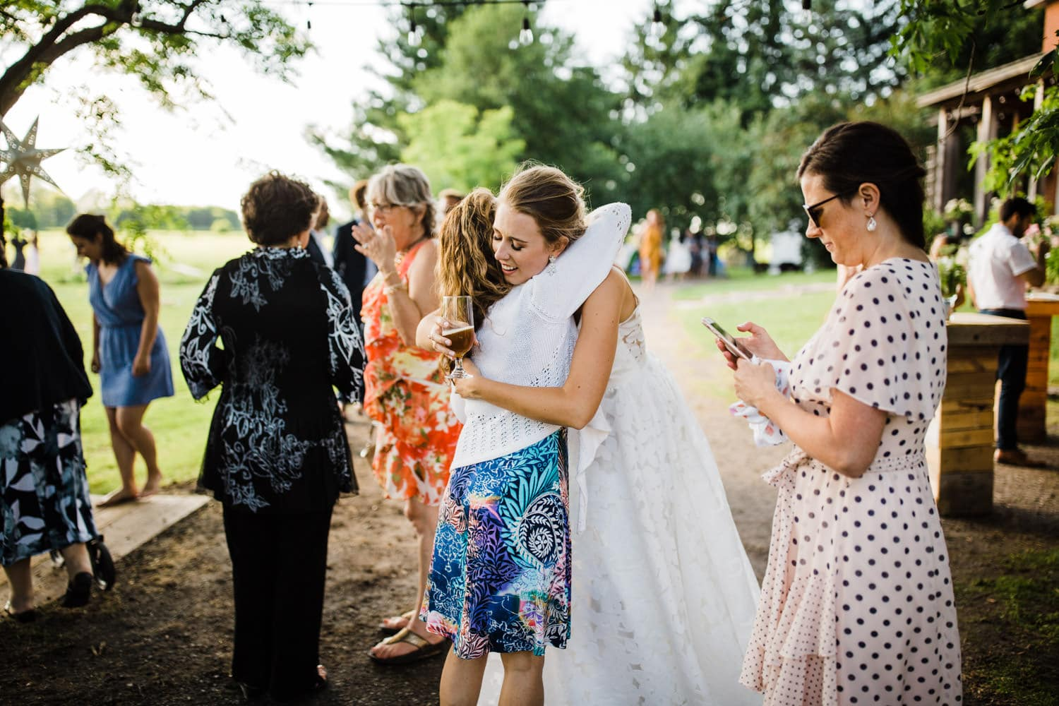bride hugs guests - ottawa backyard wedding - carley teresa photography