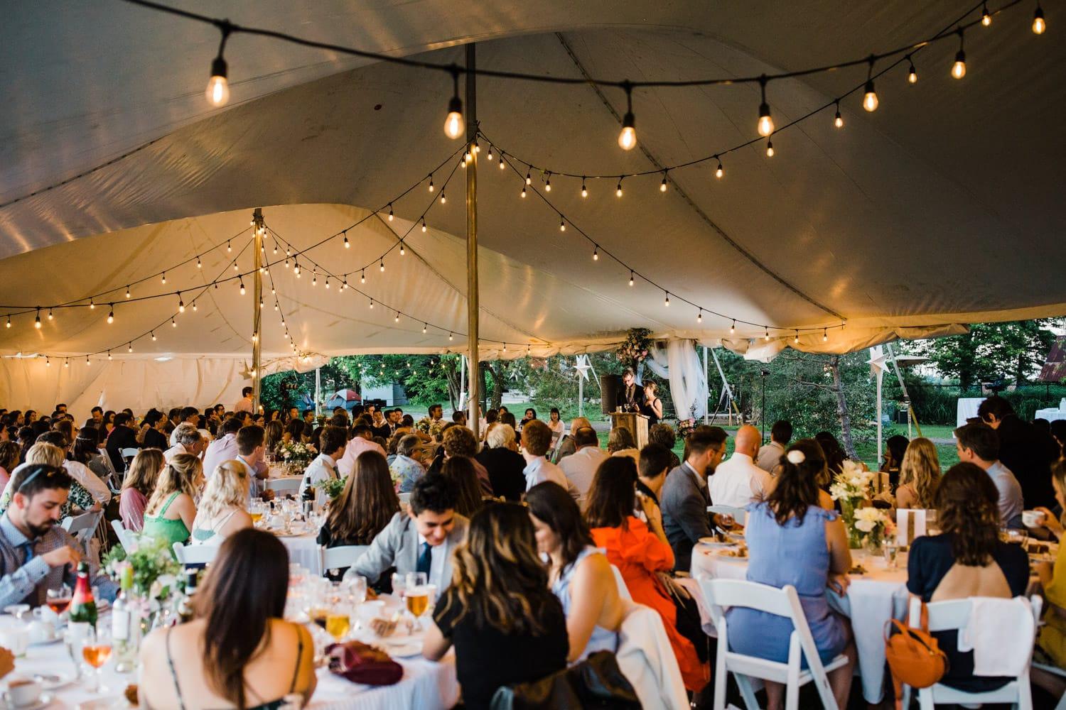 wedding speeches under a tent