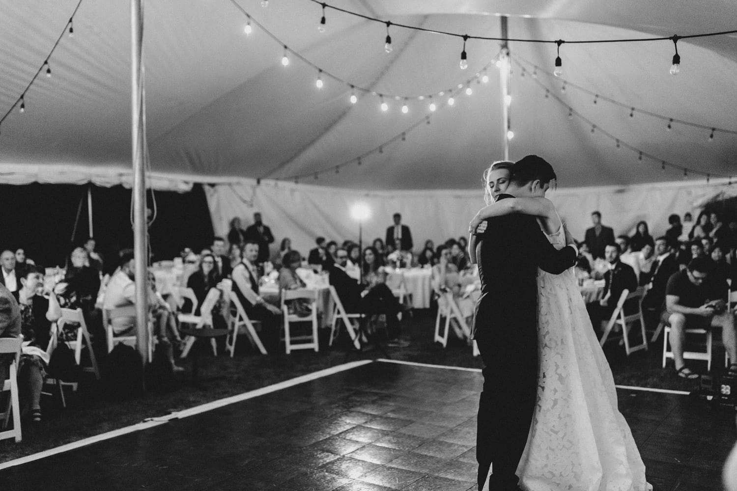 bride and groom first dance under tent - carley teresa photoraphy - ottawa backyard wedding