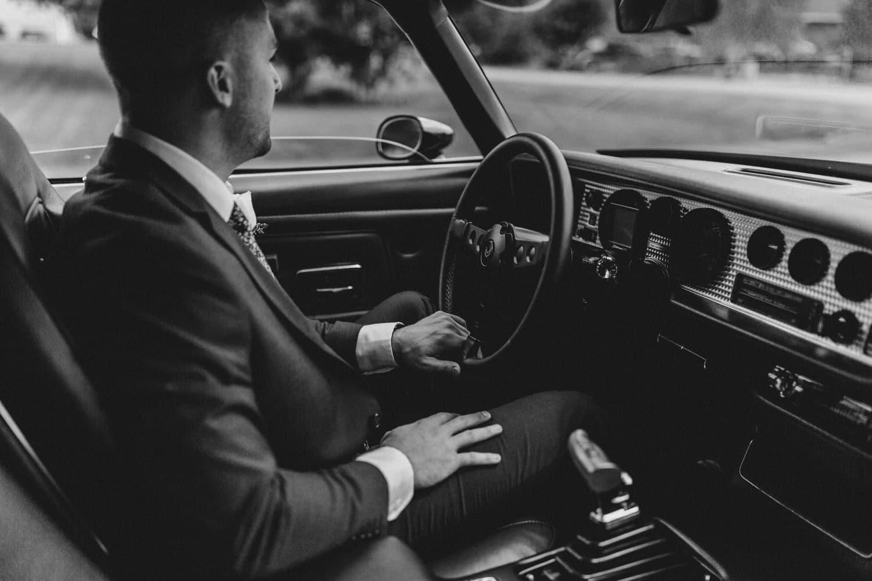groom in a vintage car