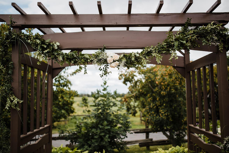 floral arrangement on arbor - summer strathmere wedding