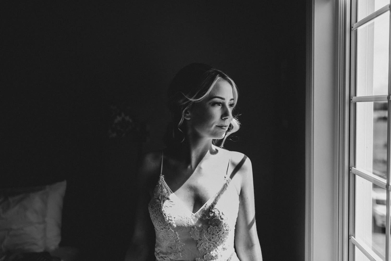 bride looks out window - summer strathmere wedding