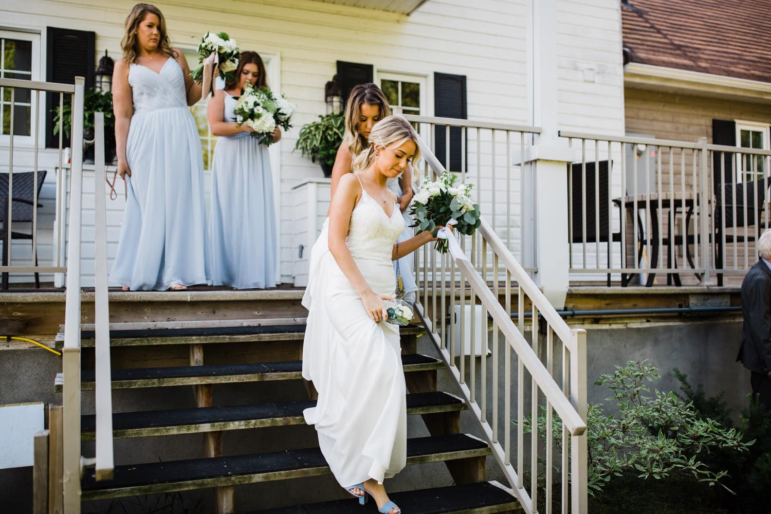 bride walks out of house for ceremony - summer strathmere wedding