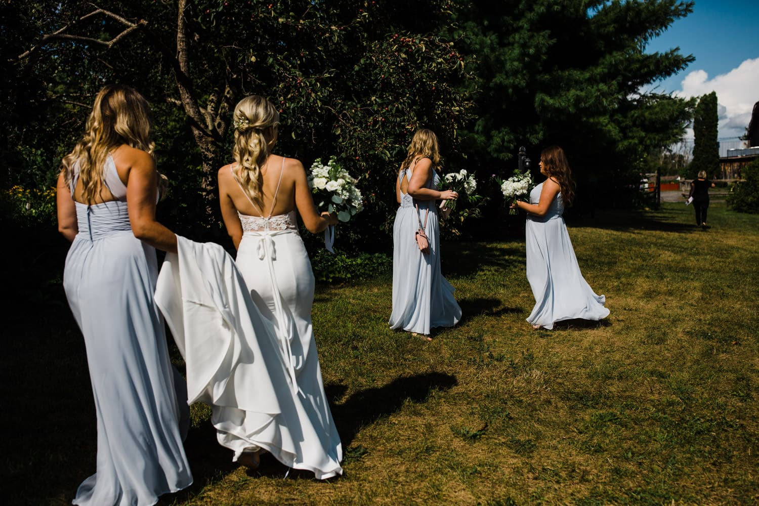 bride and bridesmaids walk over to ceremony - summer strathmere wedding - carley teresa photography