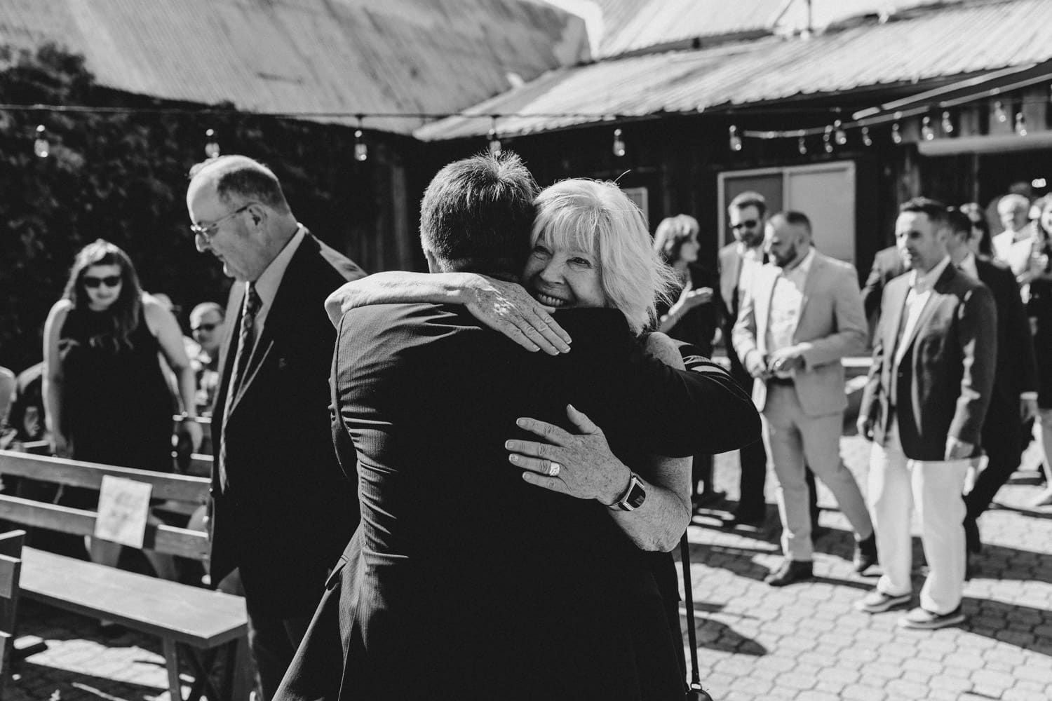 guests greet each other at the lodge - summer strathmere wedding