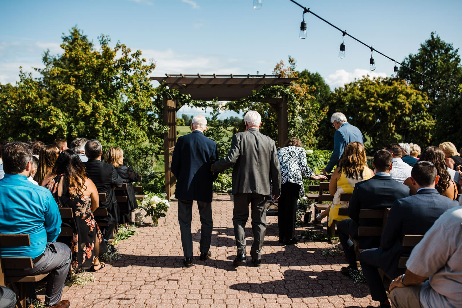 guests get ready for ceremony - summer strathmere wedding