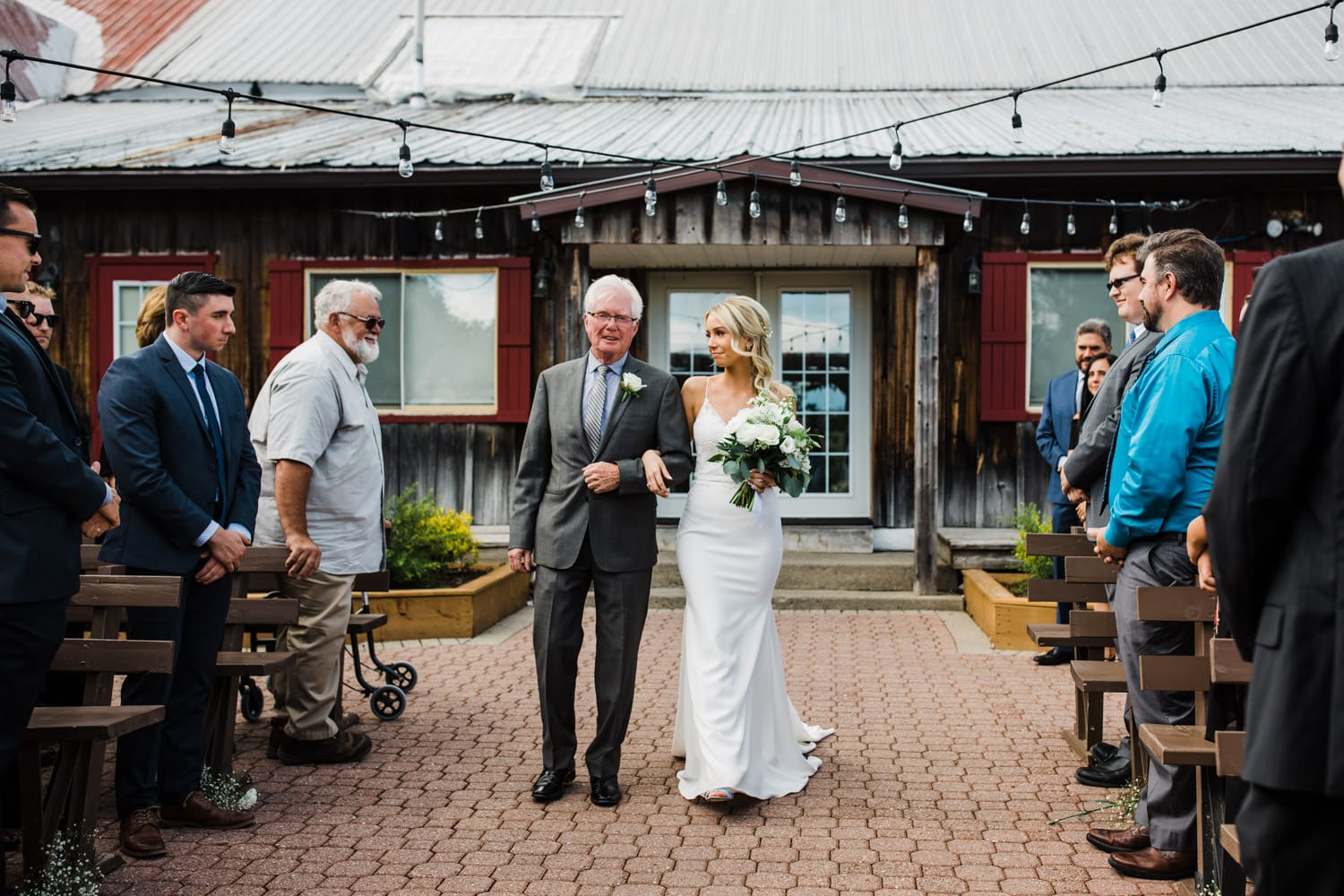 bride looks at her father as they walk down aisle together - summer strathmere wedding - carley teresa photography