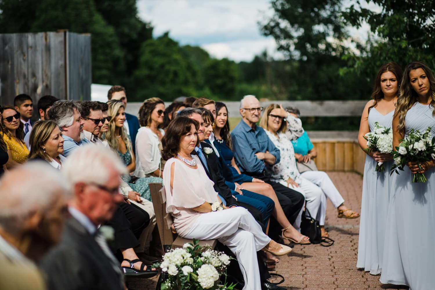 parents of groom take in the ceremony - summer strathmere wedding