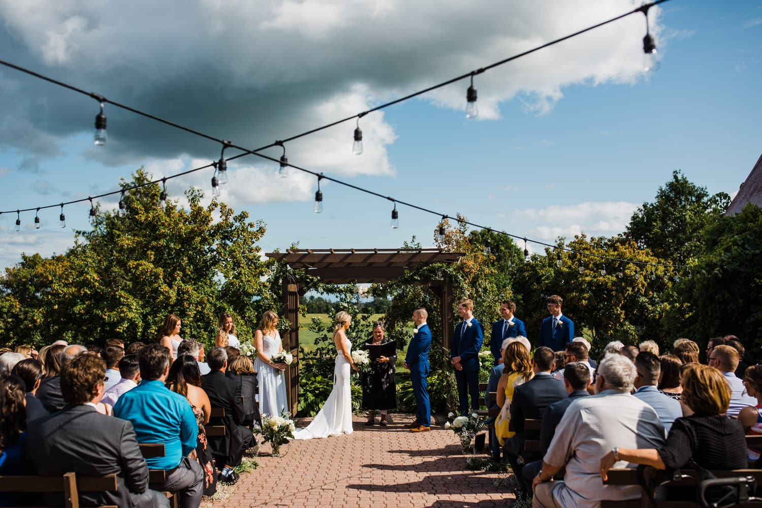 storm clouds over wedding ceremony - summer strathmere wedding - carley teresa photography