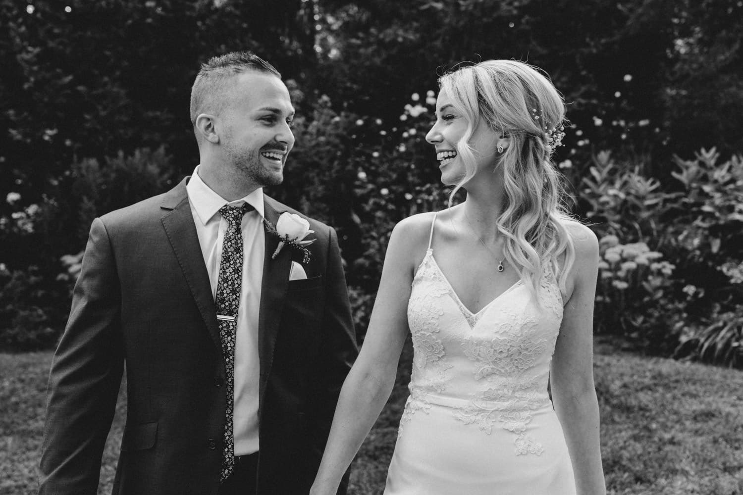 bride and groom laugh together - carley teresa photography