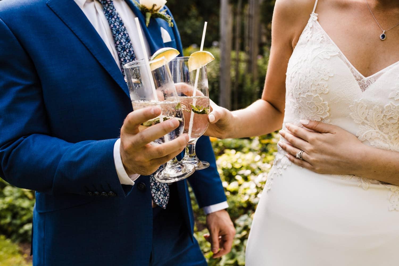 bride and grooms sip mojitos