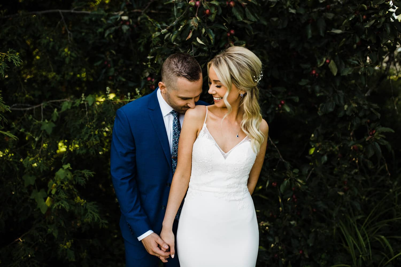 groom kisses bride's shoulder - summer strathmere wedding - carley teresa photography