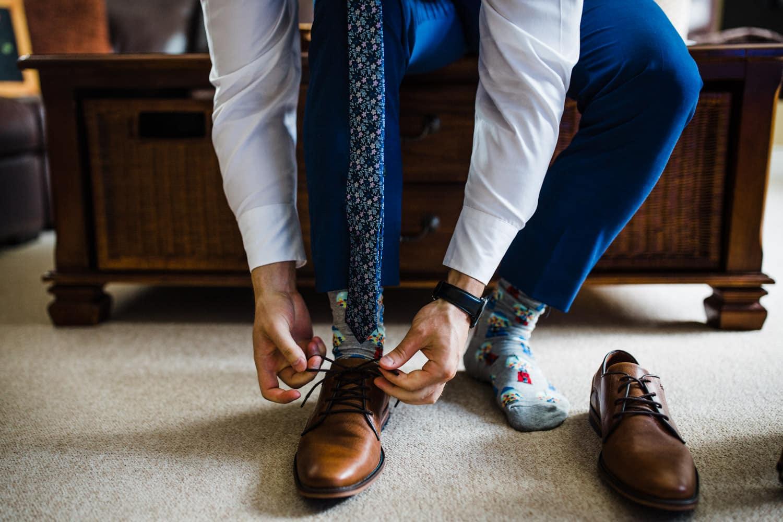 groom ties his shoes