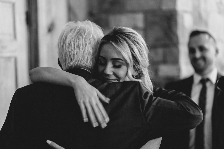bride hugs her father after speech