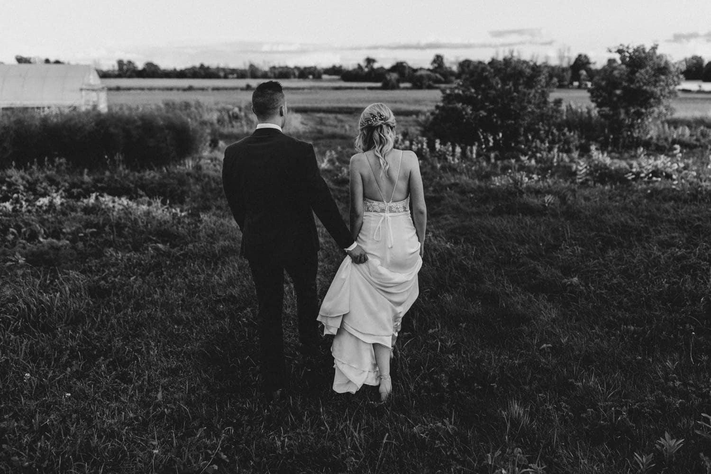 bride and groom walk towards sunset together - carley teresa photography - summer strathmere wedding