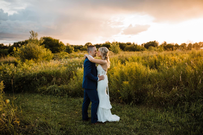bride and groom hug during sunset - summer strathmere wedding - carley teresa photography