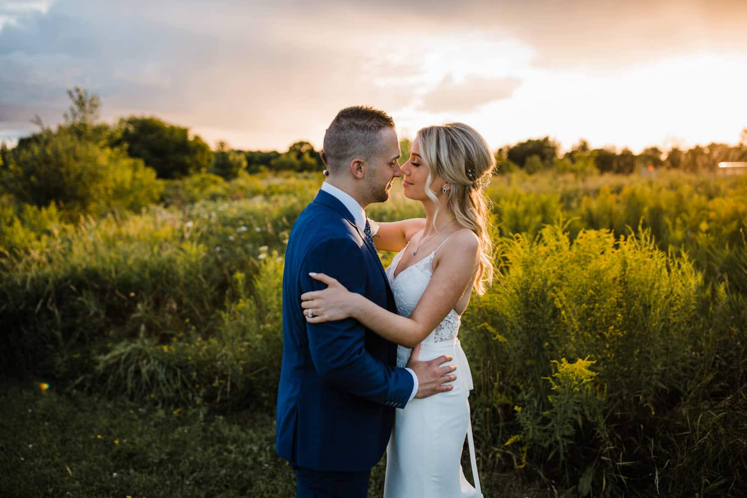 bride and groom embrace during golden hour - summer strathmere wedding - carley teresa photography