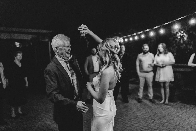 father daughter dance under string lights - summer strathmere wedding
