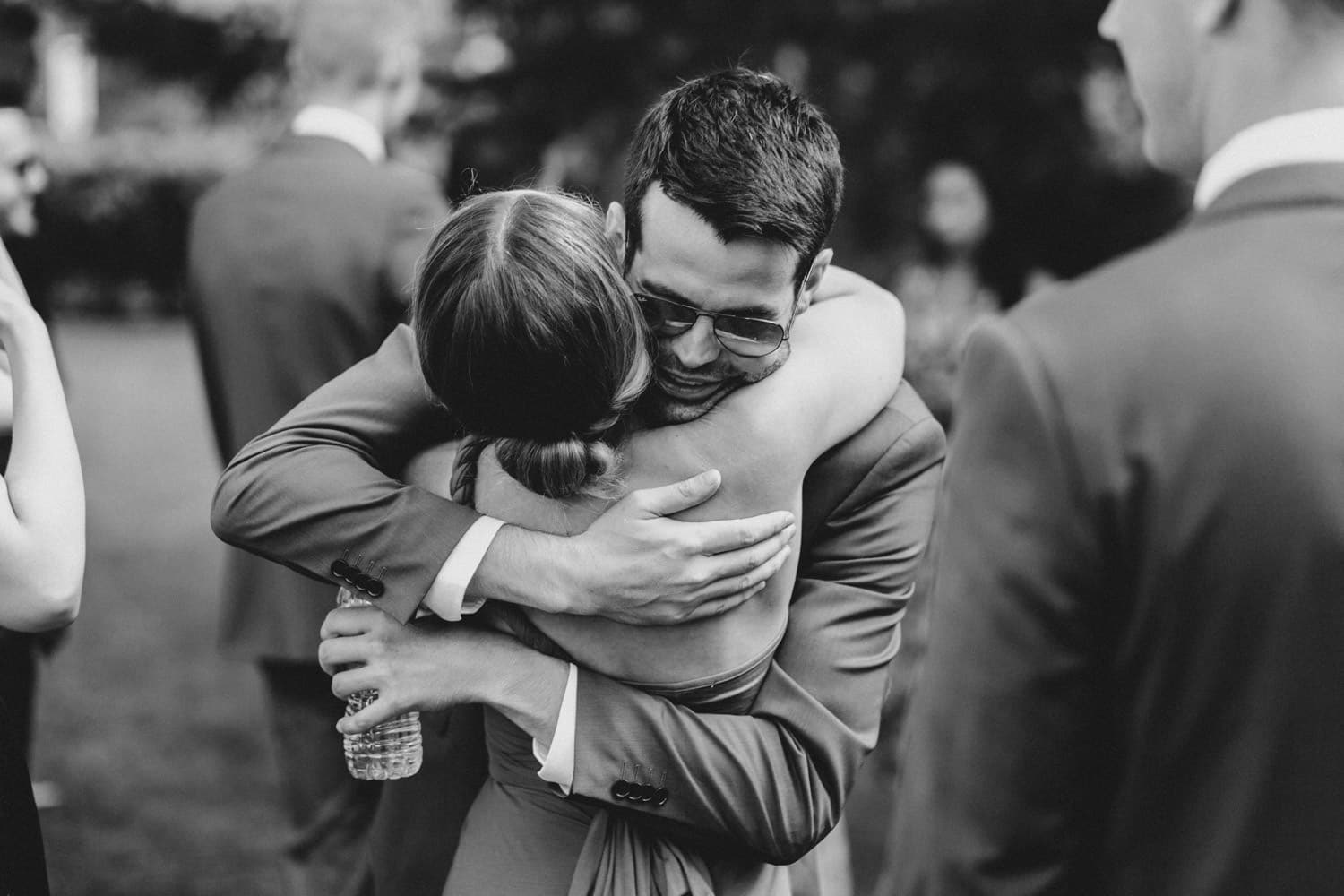 groom hugs guests at fairfield heritage house wedding = ottawa wedding photographer