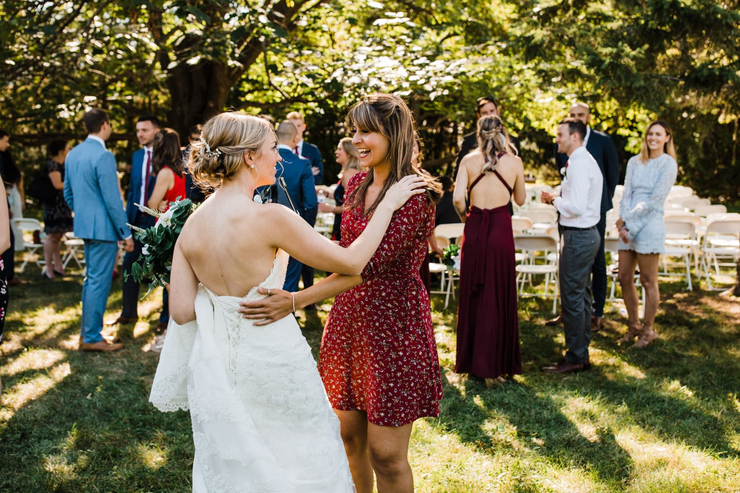 friend hugs bride after outdoor wedding ceremony - fairfield heritage house wedding