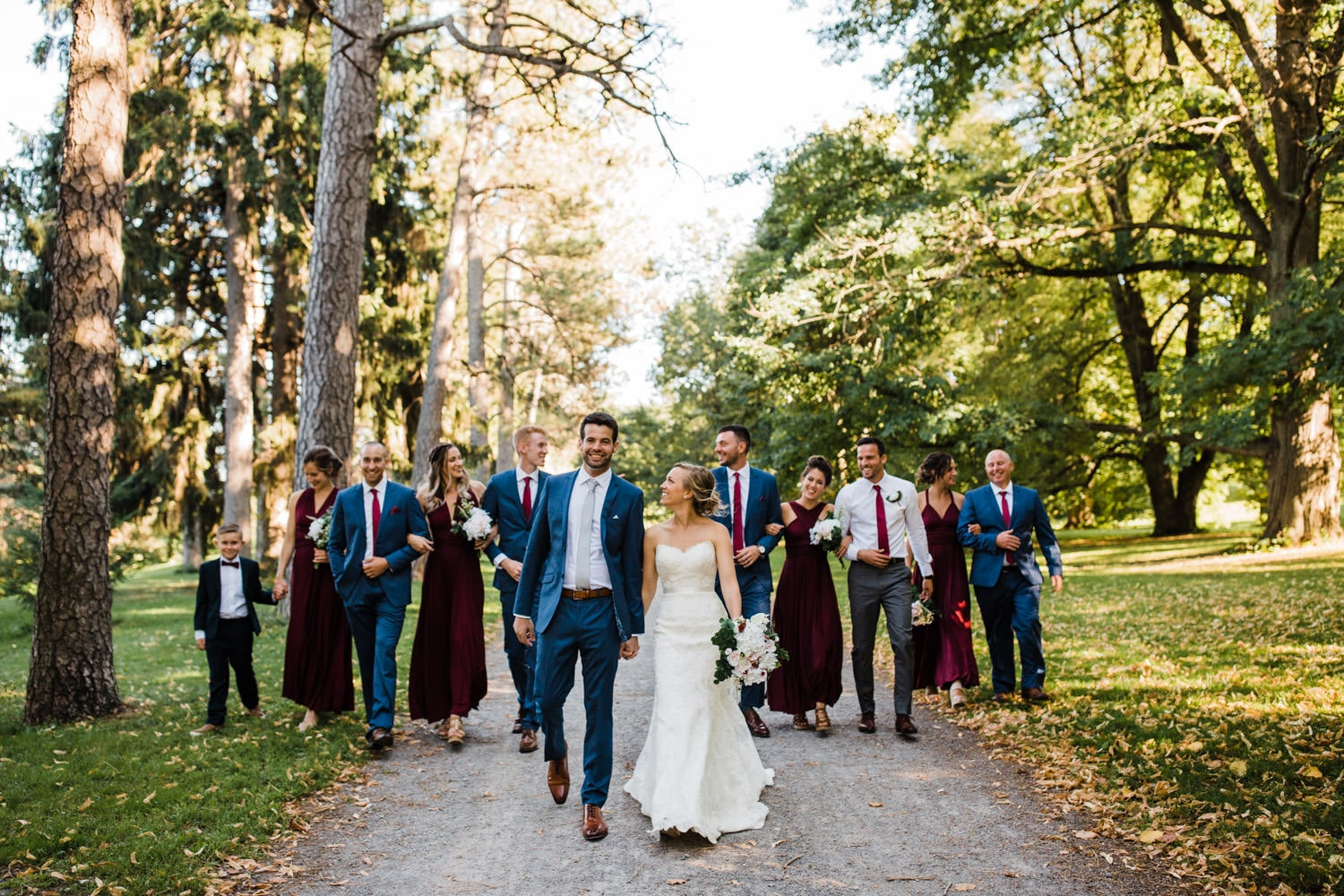 wedding party walks down stone path together - glebe community centre wedding